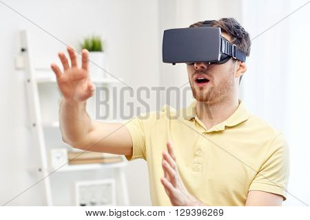 3d technology, virtual reality, gaming, entertainment and people concept - amazed young man with virtual reality headset or 3d glasses playing game