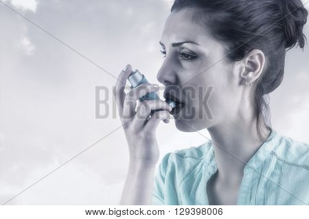 Portrait of an asthmatic woman against beige background