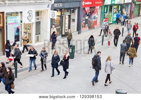 DUBLIN, IRELAND - MAY 07, 2016: People walking on the Grafton Street. The main shopping street in the city is one of the most expensive in the world.