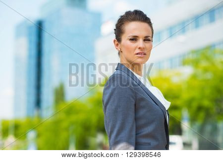 Portrait Of Confident Business Woman In Modern Office District
