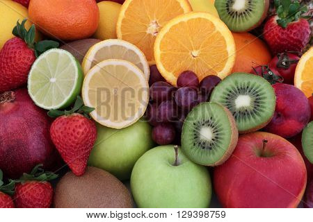 Healthy fresh fruit background with fruits high in antioxidants, vitamins, anthocyanins and dietary fiber.