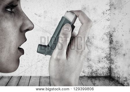 Close up on an asthmatic woman against image of a room corner