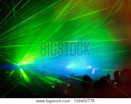 Visual effects at the concert created with lasers and smoke.
