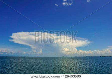 Anvil Cloud In The Sunny Day At Labuan Island. Anvil dome clouds are found in thunderstorm clouds usually in cumulonimbus clouds.