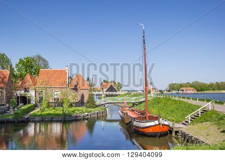 Old sailing ship in a canal in Enkhuizen Netherlands