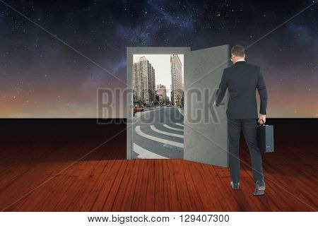 Businessman walking with his briefcase against wooden planks