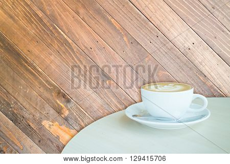 White cup of coffee latte on wooden backgound stock photo