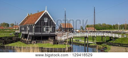 ENKHUIZEN, NETHERLANDS - MAY 9, 2016: Panorama of wooden house at the lake in Enkhuizen, Holland