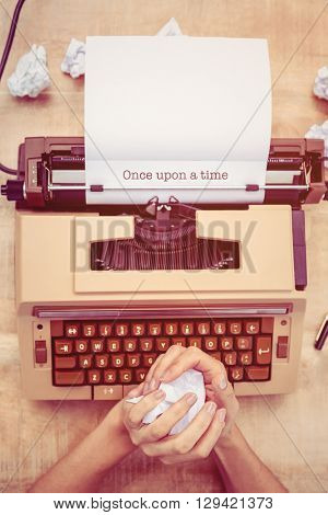 The word once upon a time against above view of old typewriter