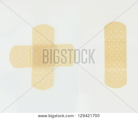 Plaster Bands In Cross Shape And Single, Isolated On White Background.