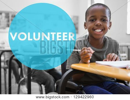 Volunteer against disabled pupil smiling at camera in classroom