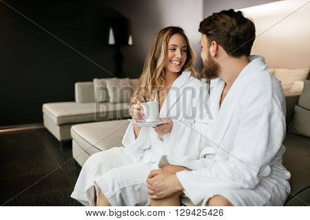Young couple enjoying wellness weekend and  spa