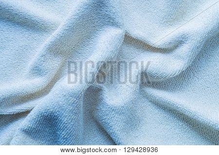 Closeup surface wrinkled blue napkin fabric background