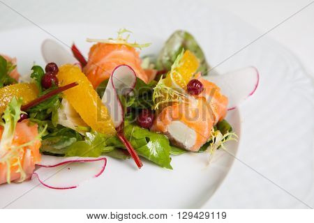 Salmon roll with cheese snack with raw vegetables