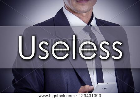 Useless - Young Businessman With Text - Business Concept