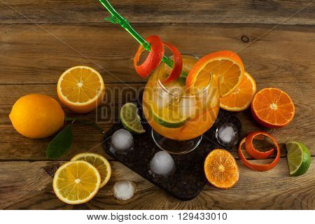Fresh citrus drink on wooden table. Fruit lemonade. Summer drink. Citrus lemonade. Fruit cocktail. Fruit drink