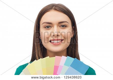 color scheme, decoration, design and people concept - smiling young woman with color swatches or samples