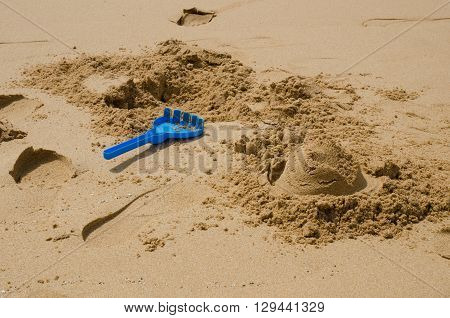 Remains of a sandcastle on the beach