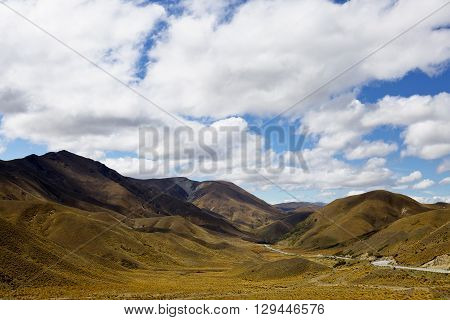 Beautiful clouds passing over Lindis Pass in New Zealand.