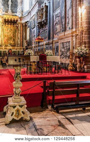 Evora, Portugal - December 1, 2015: Lectern and altar of the Evora Cathedral, the largest cathedral in Portugal. Romanesque and Gothic architecture. UNESCO World Heritage Site.