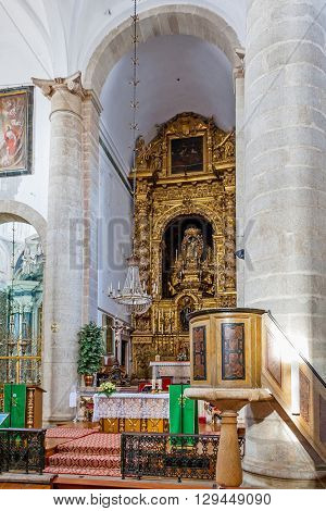 Evora, Portugal - December 1, 2015: Altar and pulpit in the Santo Antao Church. Renaissance architecture. UNESCO World Heritage Site.