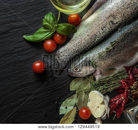 Fresh fish with spices basil and cherry tomatoes