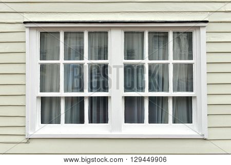 Old sash window and weatherboarding on house