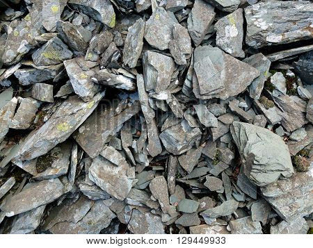 Grey scree from old slate quarry UK