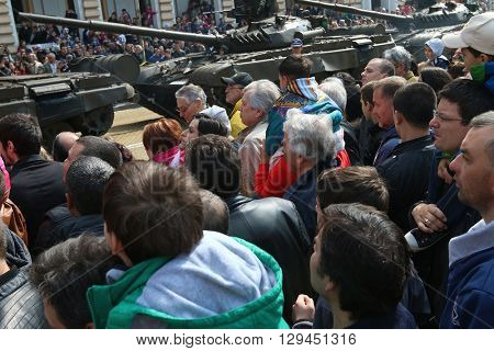 Sofia, Bulgaria - May 06: Day of Valor. Armored vehicles tracked tanks T72 on military hardware parade. Large group people. On May 06, 2016 in Sofia Bulgaria.