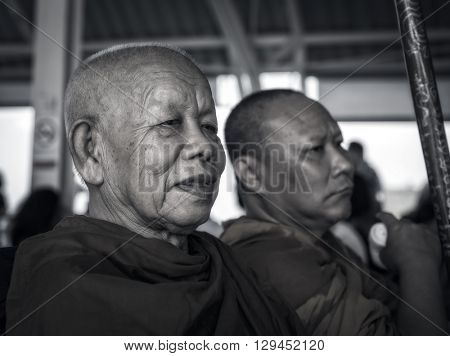 TRAT, THAILAND - MAY 8, 2016: An elderly Buddhist monk and his disciple
