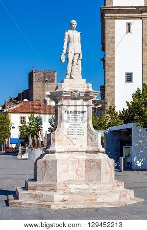 Castelo de Vide, Portugal - August 30, 2015: Dom Pedro V Square in Castelo de Vide. Dom Pedro V statue with Santa Maria da Devesa church in the back. Alto Alentejo, Portugal