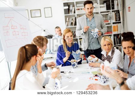 Business people eating meals in  modern office