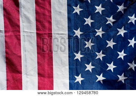 close up of american flag in sunshine half stars half stripes.