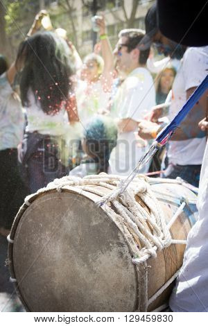 NEW YORK - APR 30 2016: Close up of a drummer performing in the crowd during the Holi Hai Festival of Colors in Dag Hammerskjold Plaza hosted by NYC Bhangra in New York on April 30, 2016.