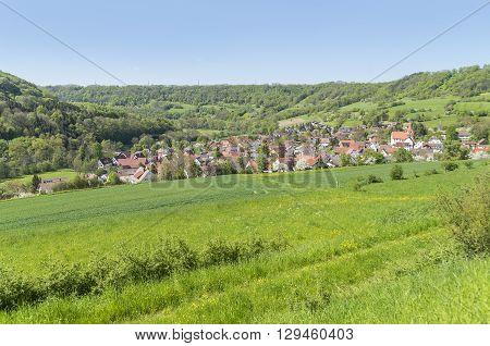 idyllic sunny spring time scenery including a town named Kocherstetten located in Hohenlohe a district in Southern Germany poster