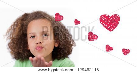 Red Hearts against a child blowing a kiss air