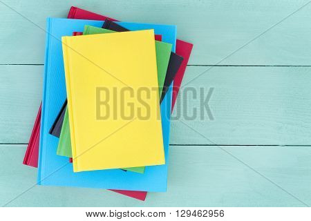 Offset Stack Of Multicolored Hardcover Books