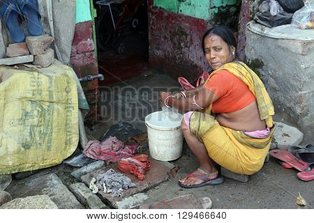 KOLKATA, INDIA - FEBRUARY 12: Ghetto and slums in Kolkata India.These unidentified people live in avery difficult conditions on the ghettos of the city in Kolkata, India on February 12, 2014