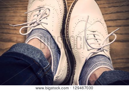 Retro white shoes on a wooden background, fifties fashion