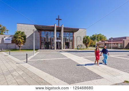 Vila Nova de Famalicao, Portugal. September 06, 2015: Couple leaving the mass in the Saint Adrian Mother Church, Portugal. Saint Adrian Mother Church / Nova Igreja Matriz de Santo Adriao.