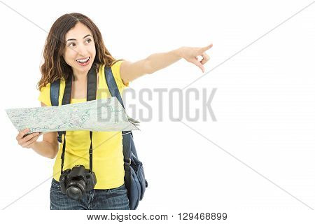 Attractive tourist woman finding the place from the map and pointing to it. Isolated on white background.