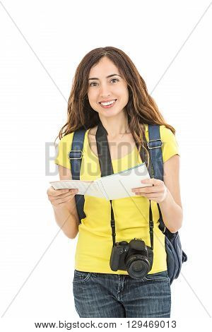 Friendly attractive female tourist with a touristic guide. Isolated on white background.