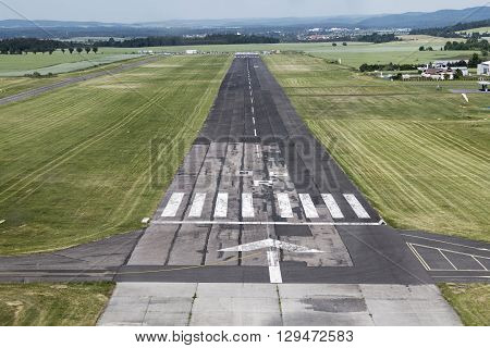 Airport runway with marking, view from landing plane