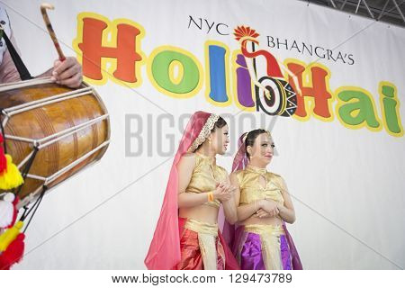NEW YORK - APR 30 2016: Two dancers on stage at the 7th annual Holi Hai Festival of Colors in Dag Hammerskjold Plaza organized by NYC Bhangra in New York on April 30, 2016.