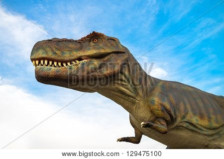 NOVI SAD SERBIA - APRIL 28 2016: Tyrannosaurus rex life-size model of prehistoric animal in dinosaurus theme entertainment Dino Park Novi Sad Serbia. T-rex was one of the largest land carnivores of all time.