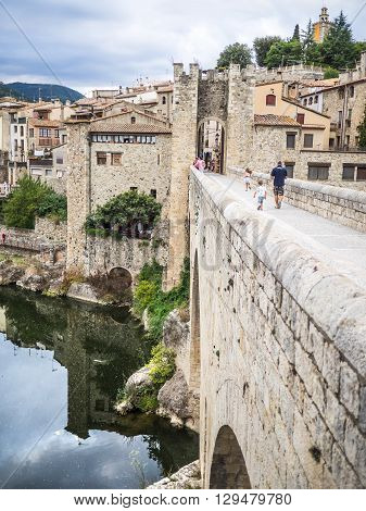 Besalu Spain - August 16 2014 - Crossing the bridge to Besalu
