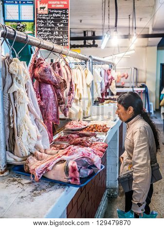 Lima, Peru - October 13 2014 - A peruvian woman buying meat on the Mercado 1 market in Surquillo Lima