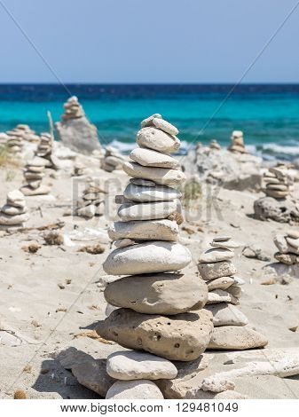 Stones piles in the Formentera Ses Illetes beach