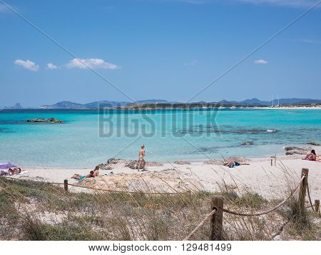 Formentera Spain - May 25 2015: View of the firsts tourists in Ses Illetes beach Formentera Spain.