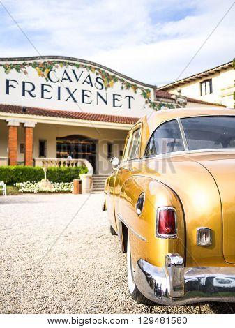 Sant Sadurni Spain - April 18 2014: Old american car in the front door of the Freixenet cava. (Text: Freixenet cava)